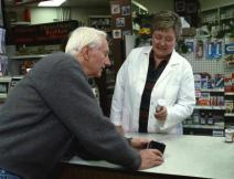 Photo of older man talking with pharmacist
