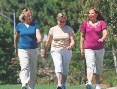 Photo of three women walking